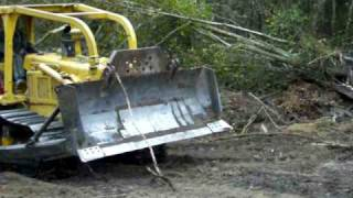 old school D6D Caterpillar dozer grading logging road part 2