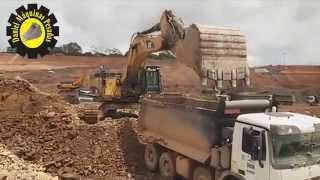 Repeat youtube video Escavadeira Hidráulica 374D L CAT trabalhando na Hidrelétrica Belo Monte