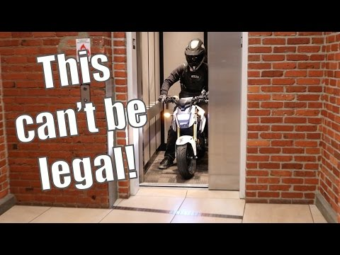 *MOTORCYCLE IN AN ELEVATOR*