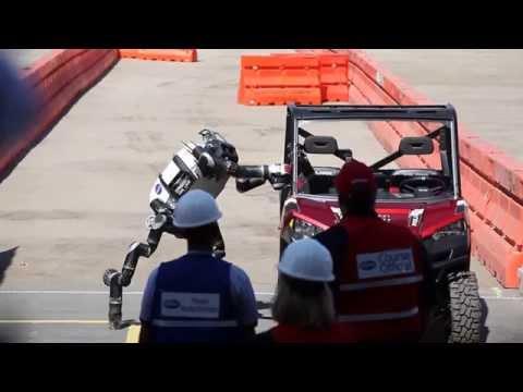 NASA Jet Propulsion Lab Robosimian robot gets out of car at DARPA Robotics Challenge