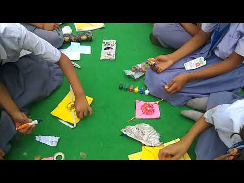 STUDENTS PARTICIPATING IN CARD & RAKHI MAKING COMPETITION