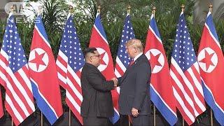 米朝首脳が初対面。笑顔で握手を交わす。 ・・・記事の続き、その他のニ...