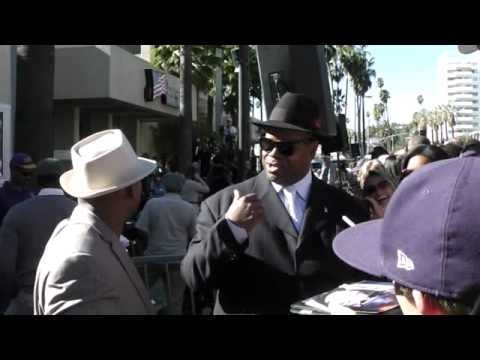 Super Producers Terry Lewis and Jimmy Jam sign autographs