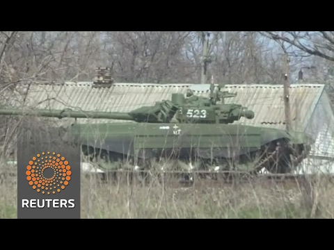 Dozens of Russian tanks deployed close to Ukrainian border