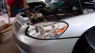 Buick Lucerne 2009 Headlight Assembly Replace 2