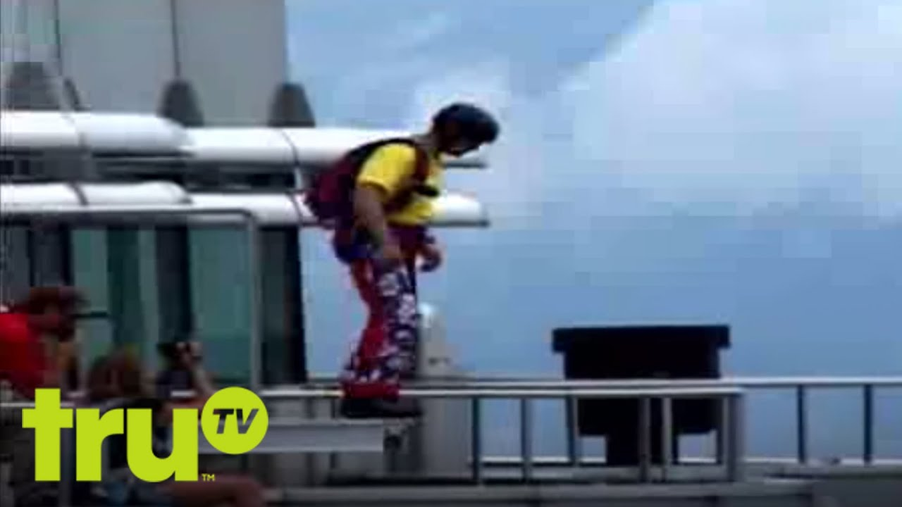 World's Wildest Vacation Videos -  Ooops Parachute - A base jumper plunges from the Petronas Towers in Malaysia.