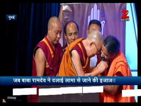 Watch : Dalai Lama tickles Baba Ramdev while he tugs Yoga guru's beard