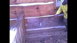 log home restoration prepping a hand hewn log home