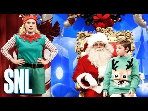 Visit with Santa Cold Open - SNL: Santa Claus (Kenan Thompson) and his elf (Kate McKinnon) field some uncomfortable Christmas present requests.  #SNL #SNL43  Get more SNL: http://www.nbc.com/saturday-night-live Full Episodes: http://www.nbc.com/saturday-night-liv...  Like SNL: https://www.facebook.com/snl Follow SNL: https://twitter.com/nbcsnl SNL Tumblr: http://nbcsnl.tumblr.com/ SNL Instagram: http://instagram.com/nbcsnl  SNL Pinterest: http://www.pinterest.com/nbcsnl/