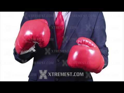 Businessman in Suit Fighting in Red Boxing Gloves