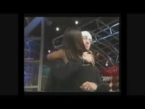 Eminem hugs and kisses a fan