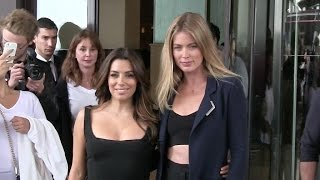 Stunning Eva Longoria and Doutzen Kroes give to the fans at the Martinez in Cannes