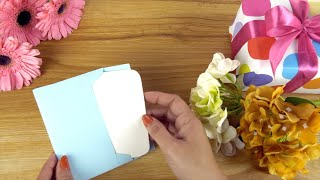 Top view shot of a blank message card with flowers and gifts - copy space concept