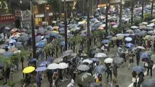 Demonstrations Continue in Hong Kong in Defiance of Face Mask Ban