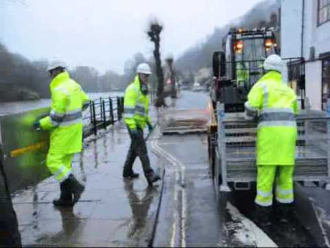 Environment Agency workers erect flood barriers in Ironbridge
