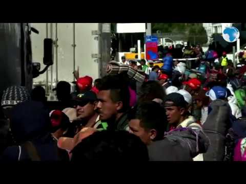 Central American migrants wait for rides to pursue their American journey