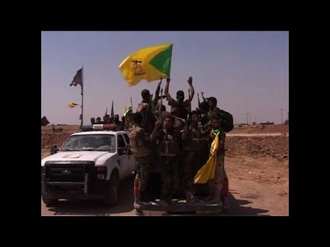 Iraqi militiamen celebrate after breaking IS siege of Amerli