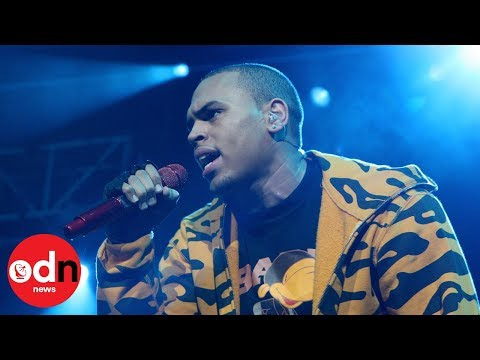 Rapper Chris Brown in custody over rape allegations Mp3
