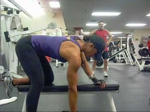 Kai Performs One Arm Rows To Target The Lats