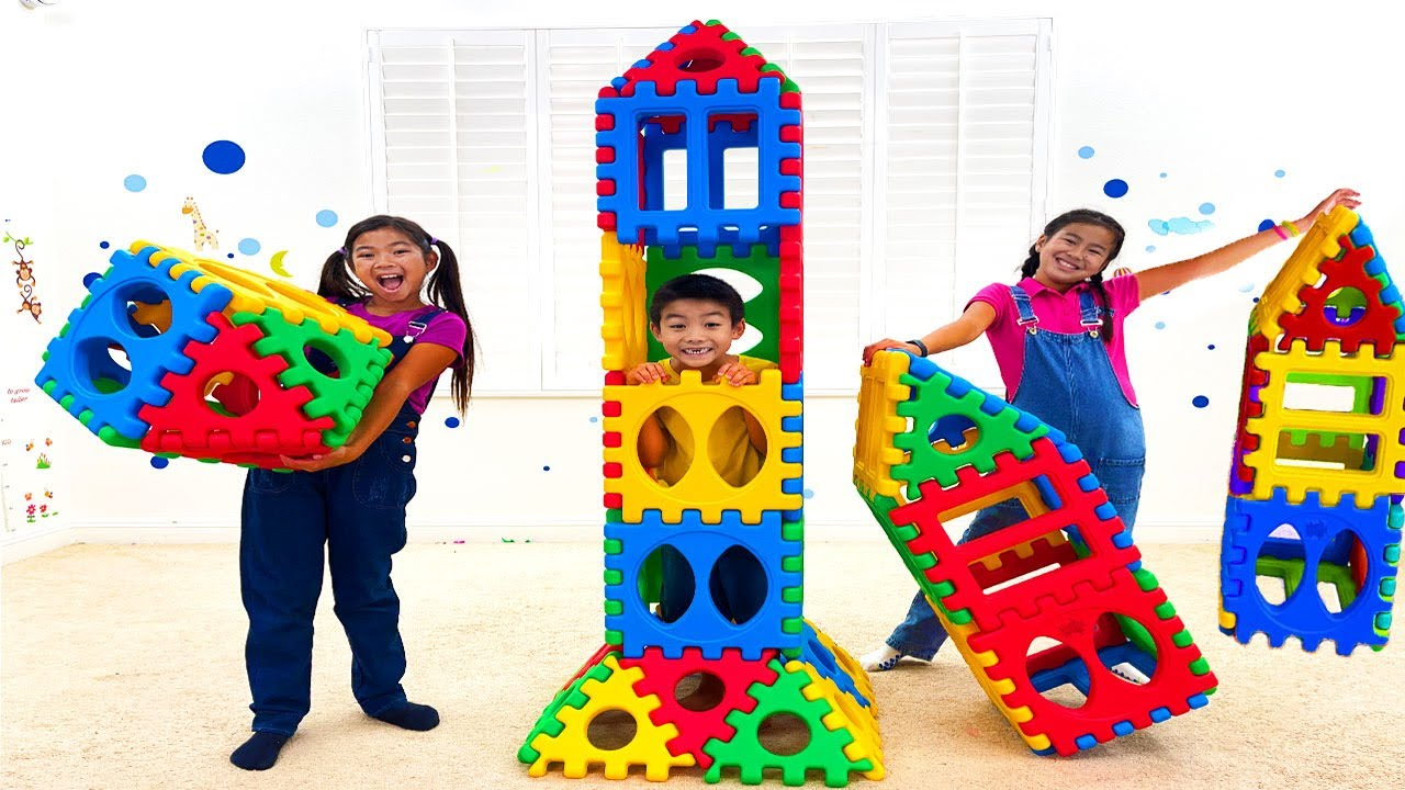 Jannie Emma & Eric Build a Rocket from Toy Blocks   Kids Learn about Recycling and Sharing