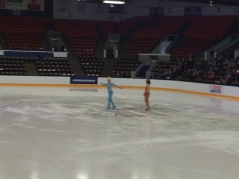 Someone Performs the Blades of Glory Routine at an Ice Skating Competition