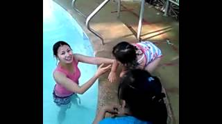 Scarlet jump in swimming pool