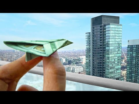 THROWING $100 PAPER AIR PLANES FROM A BUILDING!