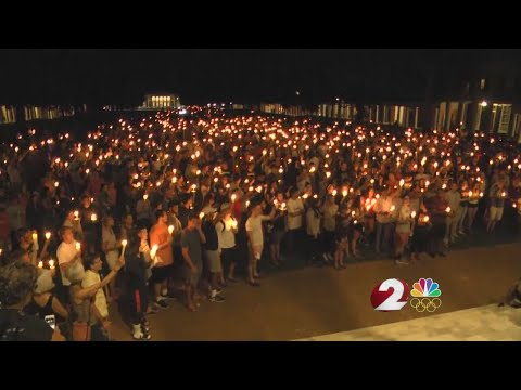 Peaceful candlelight vigil moves through UVA campus for Charlottesville