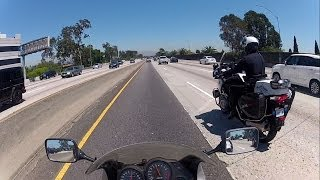 Fast CHP LAPD Motorcycle Police Officer Splitting Lanes in Los Angeles
