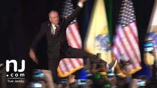 Phil Murphy leaps onto the stage for victory speech