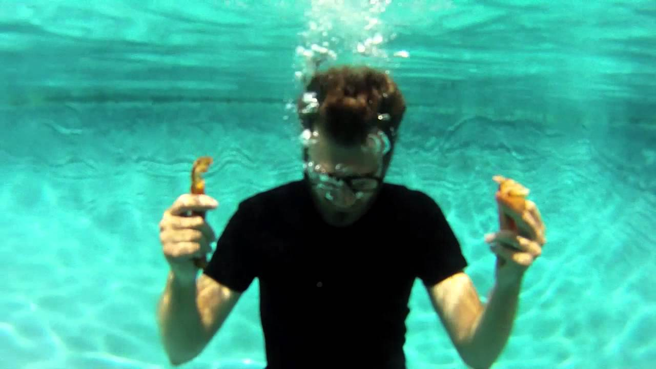 HIDDEN: Underwater Bacon - A hidden behind the scenes video showing Rhett in a swimming pool with some strips of bacon.  The video is linked to from the video 'Rub Some Bacon on It'.