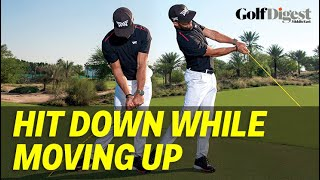 Still trying to hit down? Learn how great players compress the ball while pulling up!