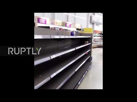 Supermarket, stormed! Blizzard panic-buying sees BREAD swept from the shelves