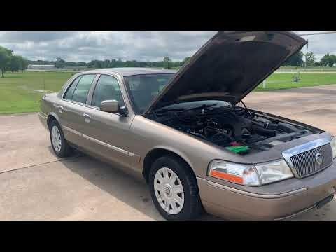 2005 GOLD Mercury Grand Marquis GS (2MEFM74W25X) with an 4.6L V8 OHC 16V engine, 4-Speed Automatic Overdrive transmission, located at 17760 Hwy 62, Morris, OK, 74445, (918) 733-4887, 35.609104, -95.877060 - Photo #0