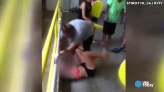 Video shows teacher dragging bikini-clad girl to pool