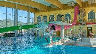 Pink Jump Drop Slide at AquaMagis Plettenberg