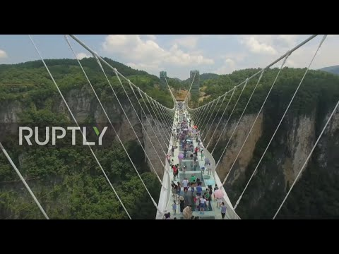 China: World's longest glass-bottom bridge opens in Hunan province
