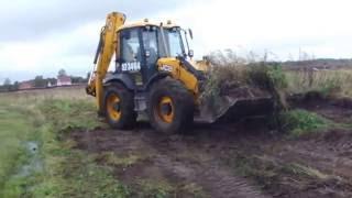 планировка участка трактором  JCB - срезка бугров