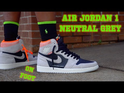AIR JORDAN 1 RETRO HIGH OG NEUTRAL GREY HYPER CRIMSON ON FOOT