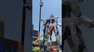 Freedom Gundam head installation.