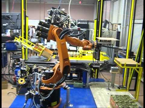 Kuka robot boxing jars and stacking boxes on pallets