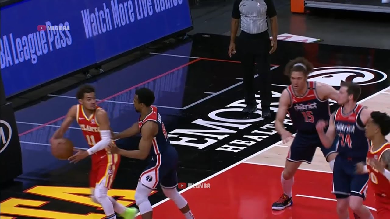 Trae Young nearly falling out of bounds passes behind his back to Tony Snell