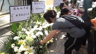 Hong Kong residents mourn death of 70-year-old sanitation worker hit by rioters