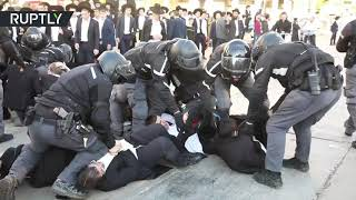 Chaos, scuffles & arrests as ultra-Orthodox Jews protest military draft