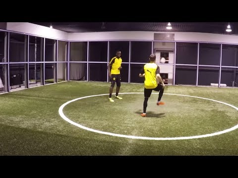 Usain Bolt and Christian Pulisic in the Footbonaut