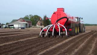 slurry tanker injecting manure with case ih tractor
