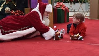 Santa Lies on Floor for Boy With Autism for Perfect Christmas Photo