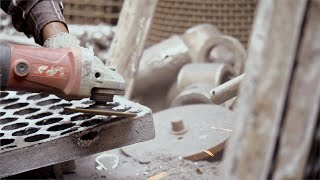 Worker polishing metal with grinder - sparks coming out in process