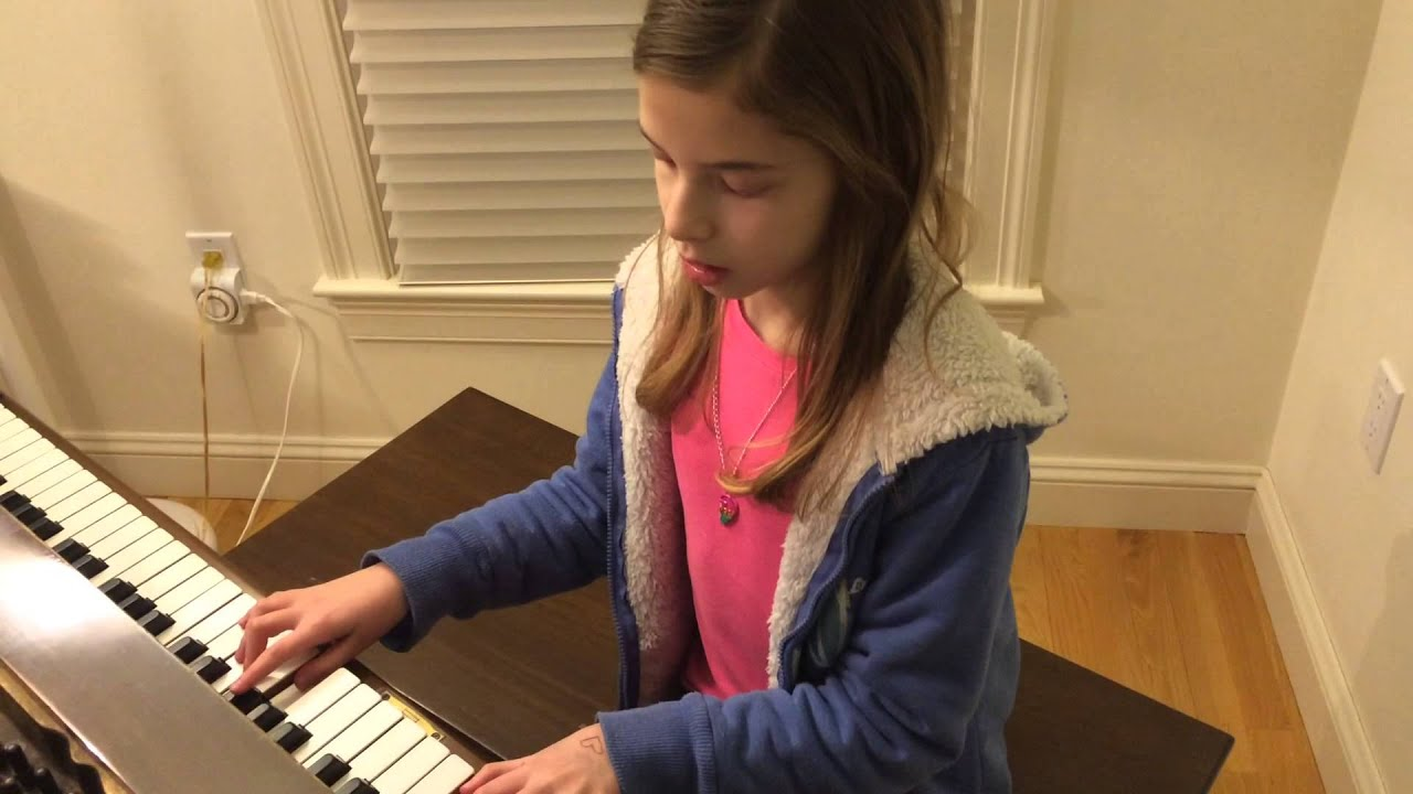 10 year old girl plays piano and sings Let It Go from