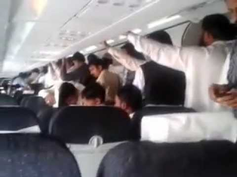 NAS air Flight from Lahore to Riyadh and Passengers are standing and ready escape.